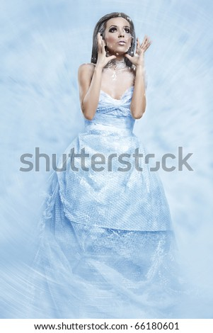 portrait of a girl in a blizzard of snow that looks like a snow queen