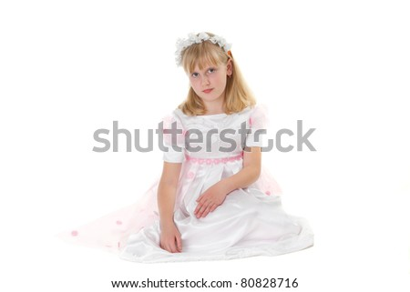 Portrait of a girl in a dress for first communion