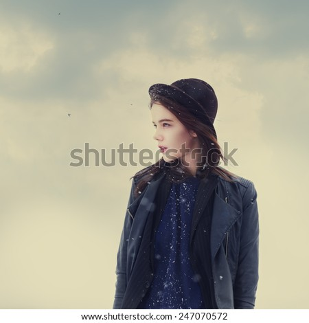 portrait of a girl in a hat hipster - stock photo