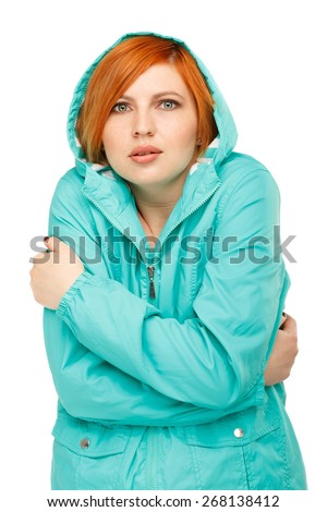 portrait of a girl in a jacket with a trembling from the cold Isolated on white background - stock photo