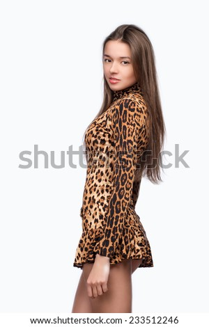 Portrait of a girl in a short dress with a tiger coloring - stock photo