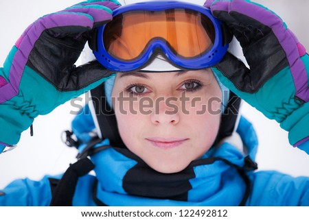 portrait of a girl in a ski suit