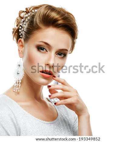 Portrait of a girl in a white dress and jewelry in a high key. Isolated on white background. - stock photo