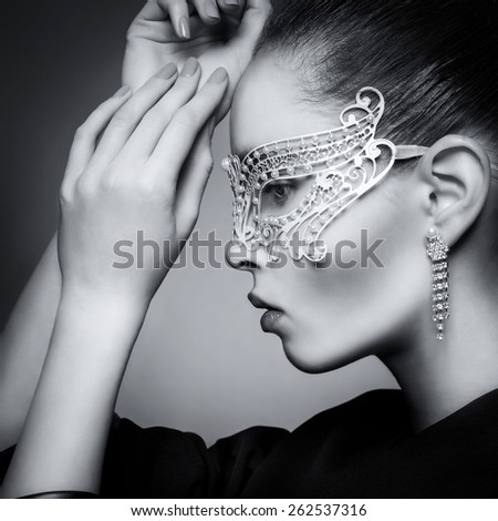 Portrait of a girl in carnival mask - stock photo