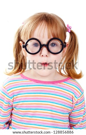 Portrait of a girl in funny eyeglasses looking at camera - stock photo