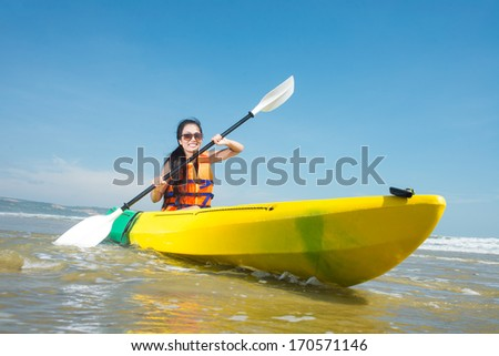 Portrait of a girl in kayak - stock photo