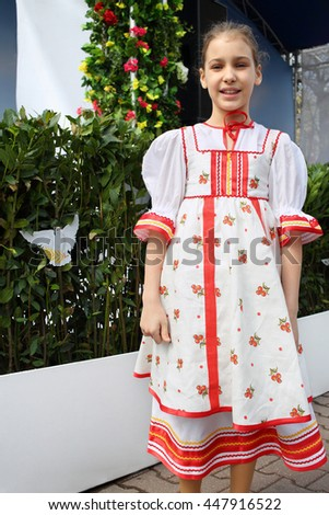 Portrait of a girl in Russian national dress in the Moscow Spring Festival - stock photo