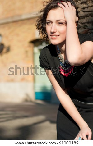 Portrait of a girl on a town street - stock photo