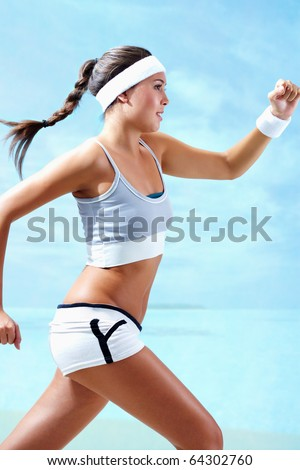 Portrait of a girl running against blue background - stock photo