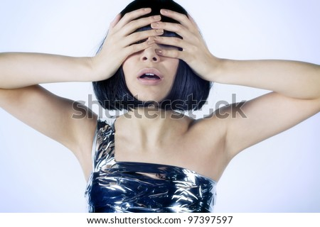 Portrait of a girl's face was covered with her ??hands - stock photo
