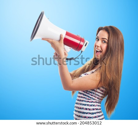 portrait of a girl shouting with a megaphone - stock photo