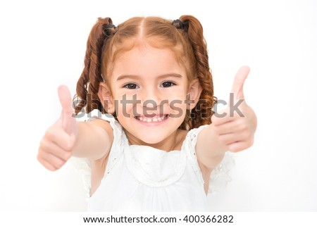 Portrait of a girl showing thumbs up isolated one white - stock photo