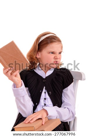 Portrait of a girl teenager reading book. Isolated over white background. - stock photo