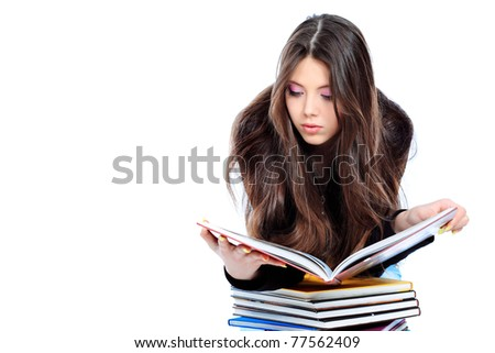 Portrait of a girl teenager reading book. Isolated over white background.