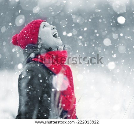 portrait of a girl who catches snowflakes mouth portrait snow christmas - stock photo