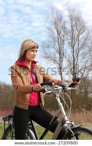 Portrait of a girl with a bicycle - stock photo
