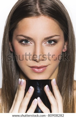 portrait of a girl with a cup of coffee or tea - stock photo