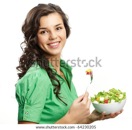 Portrait of a girl with bawl of salad looking at camera