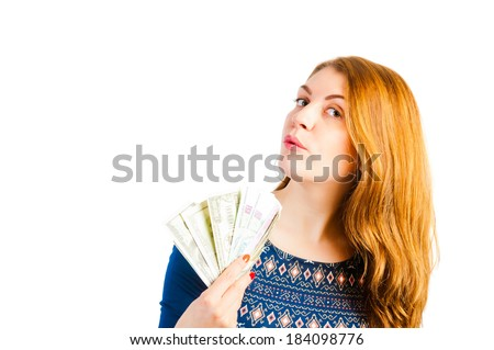 portrait of a girl with beautiful eyes with money - stock photo