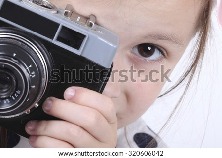 Portrait of a girl with camera on white background