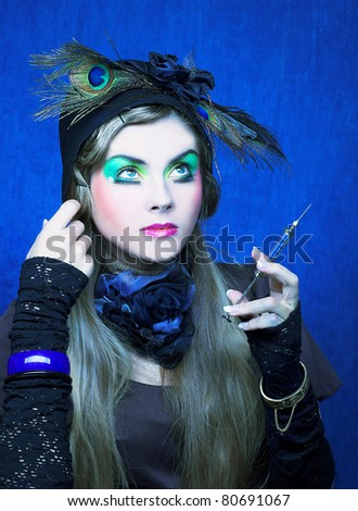 Portrait of  a girl with creative make-up in doll style - stock photo