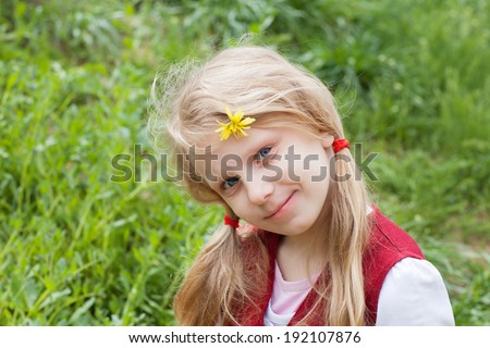 portrait of a girl with flower in hair - stock photo