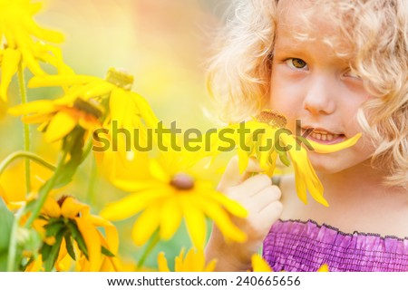 Portrait of a girl with flowers - stock photo