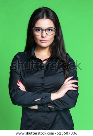portrait of a girl with glasses on a green background