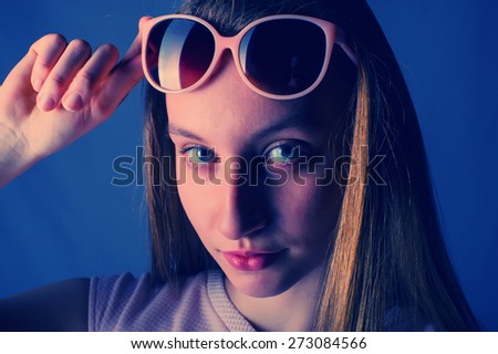 portrait of a girl with her hair in sunglasses
