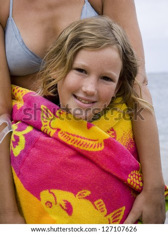 Portrait of a girl with her mother standing behind her - stock photo