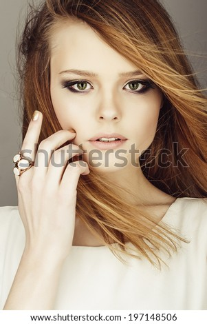 Portrait of a girl with red hair in a studio, closeup - stock photo