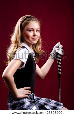 portrait of a girl with the golfclub - stock photo