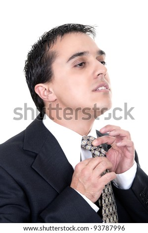 Portrait of a good looking businessman against white background straightens his tie - stock photo