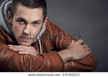 Portrait of a good looking man in classic leather jacket - stock photo