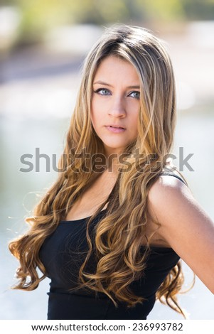 Portrait of a gorgeous and young blond girl with long hair - stock photo