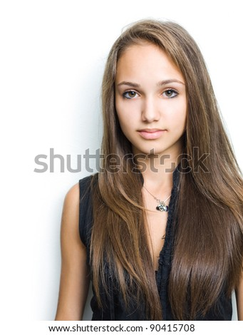Portrait of a gorgeous confident young brunette girl. - stock photo