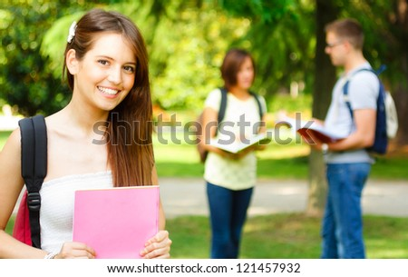 Portrait of a gorgeous smiling student - stock photo