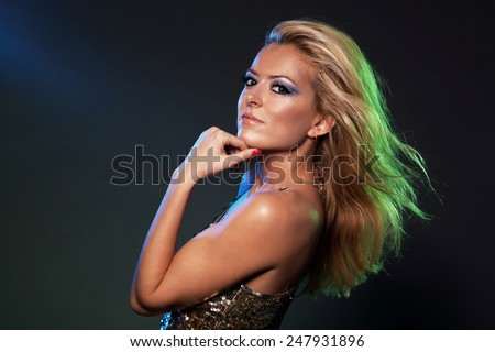 Portrait of a gorgeous woman with flying hair - stock photo