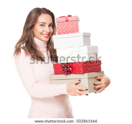 Portrait of a gorgeous young brunette woman holding decorative Christmas gift boxes.