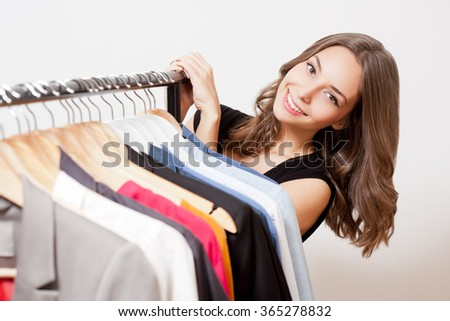 Portrait of a gorgeous young brunette woman shopping clothes. - stock photo
