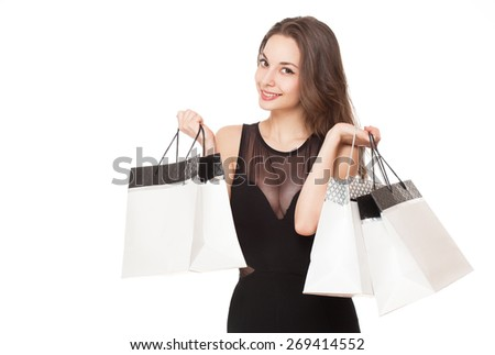 Portrait of a gorgeous young brunette woman with shopping bags. - stock photo