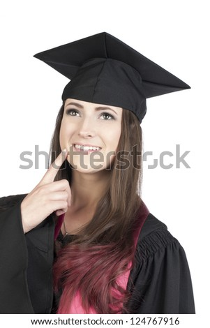 Portrait of a graduate student with her hand pointing at her face while looking up over the white background - stock photo