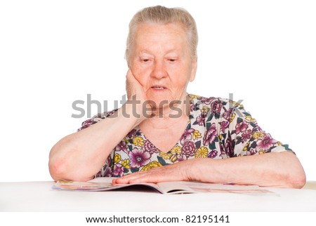 portrait of a granny reading a book - stock photo