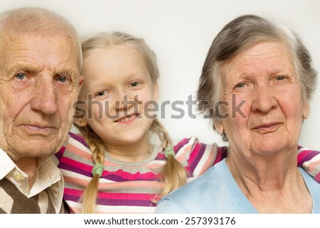 portrait of a great-grandmother, great-granddaughter and  grandfather, close-up