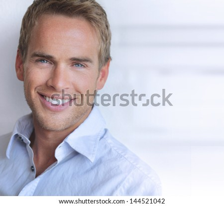 Portrait of a great looking confident young man with big real smile - stock photo