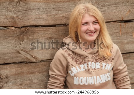 Portrait of a green-eyed blonde girl wearing sweater - stock photo