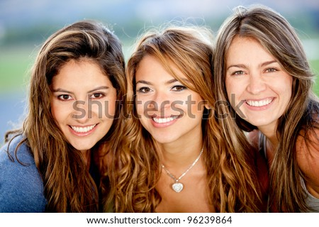 Portrait of a group of beautiful female friends smiling - stock photo
