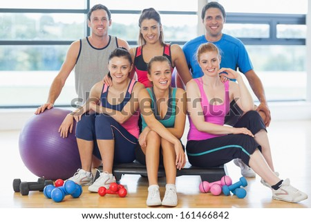 Portrait of a group of fitness class at a bright exercise room - stock photo