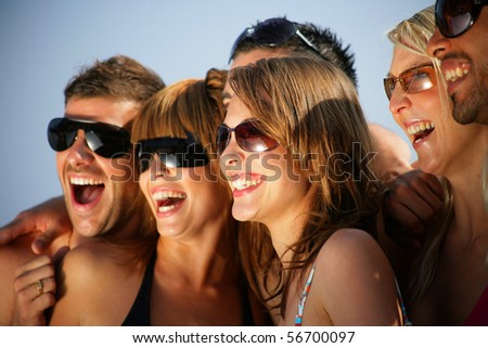 Portrait of a group of friends at the beach - stock photo