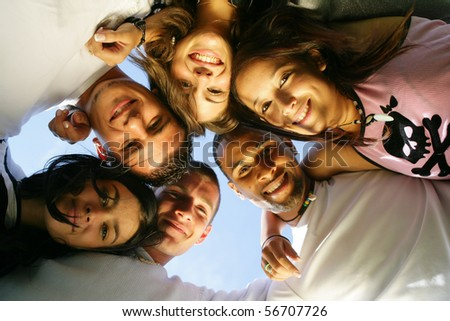 Portrait of a group of friends smiling - stock photo